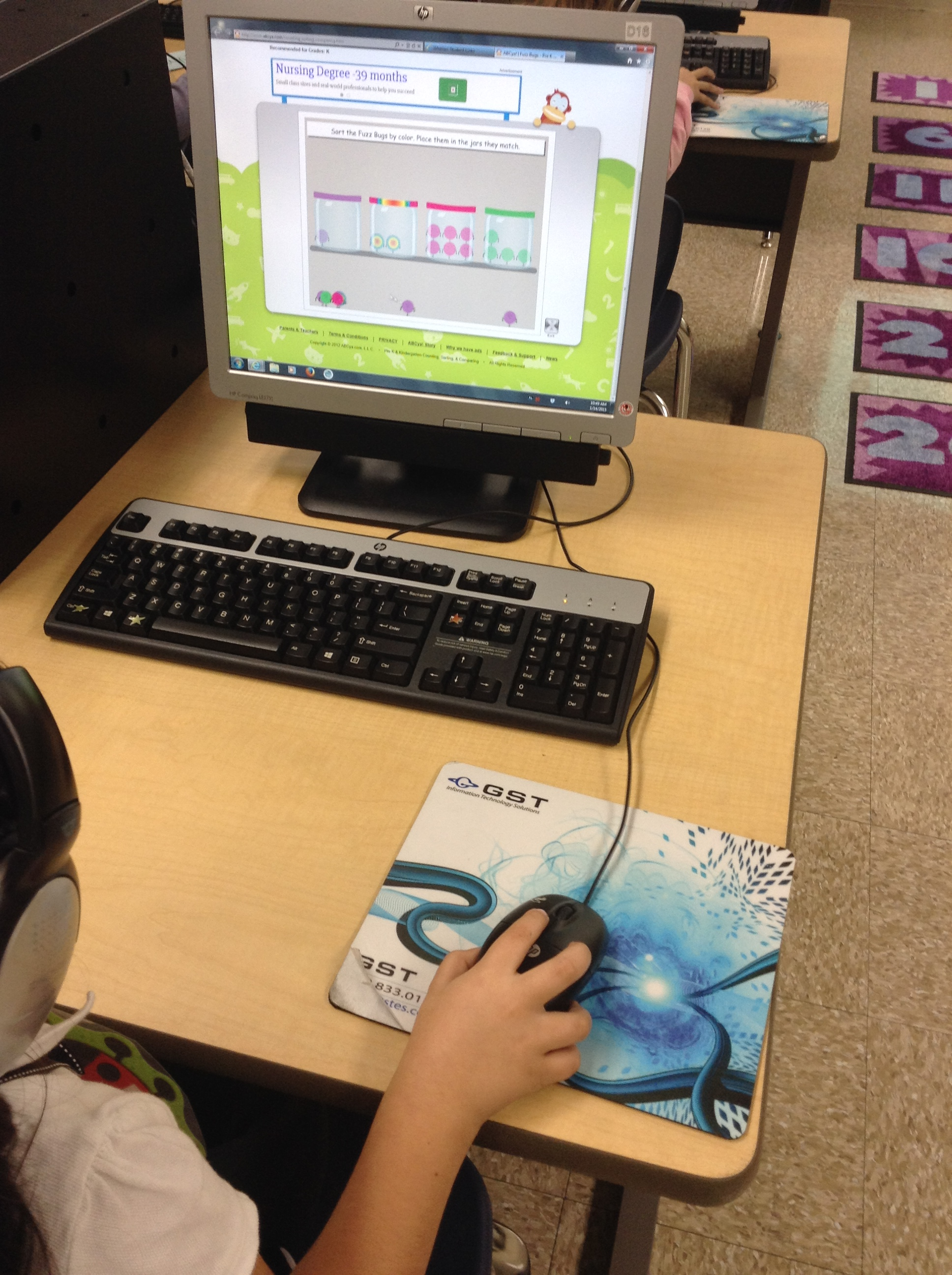 student using a computer learning game