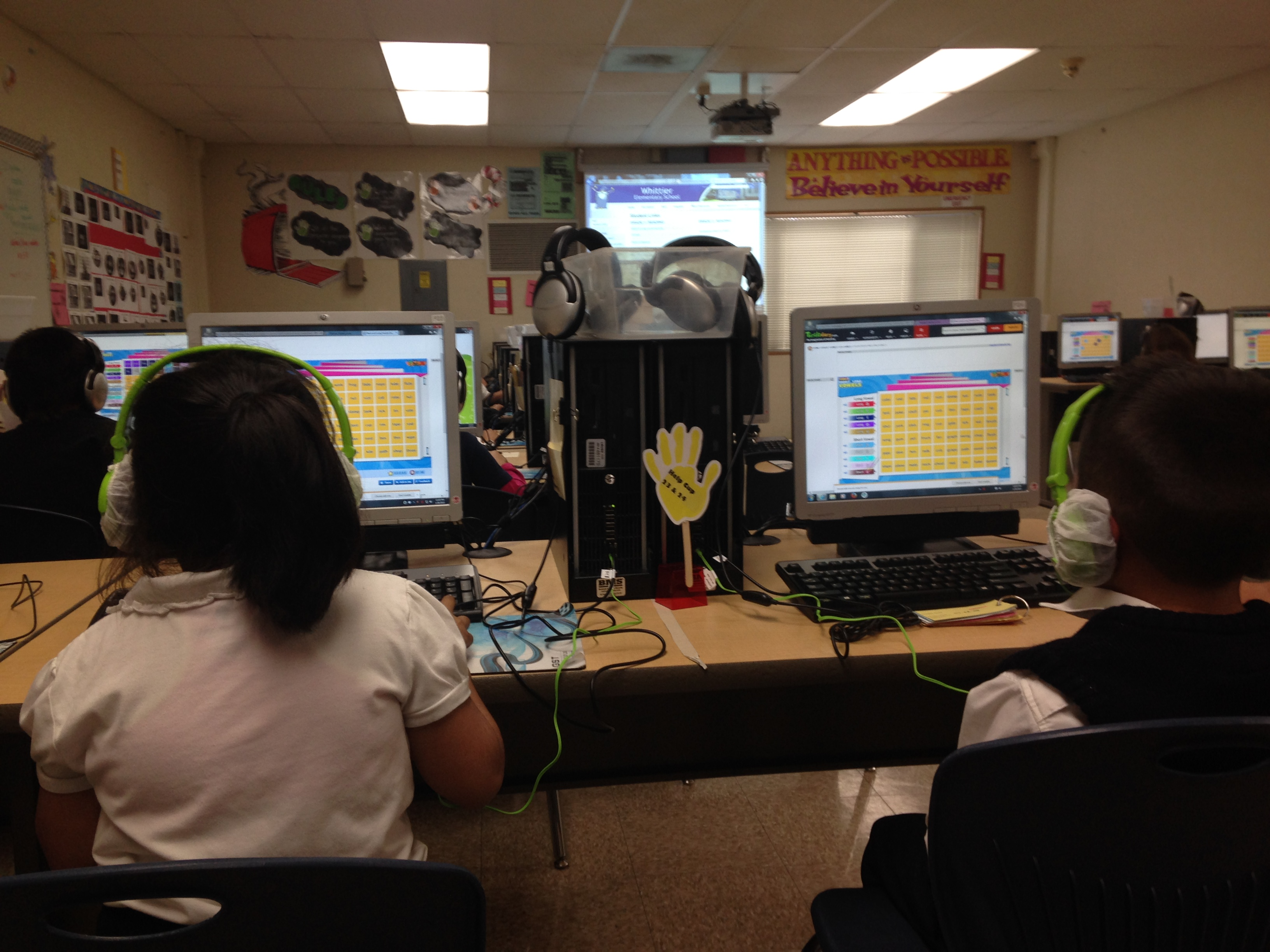 students using a computer program in class
