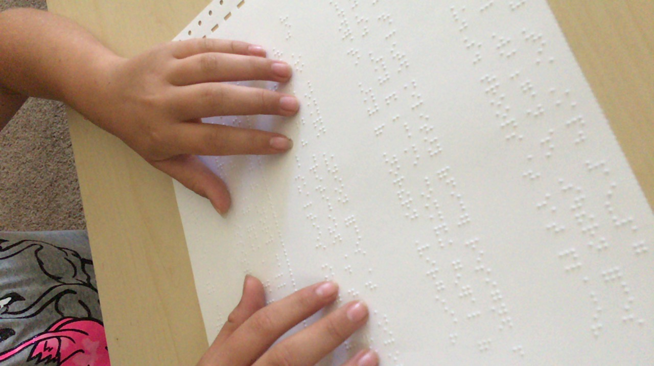child reading brail