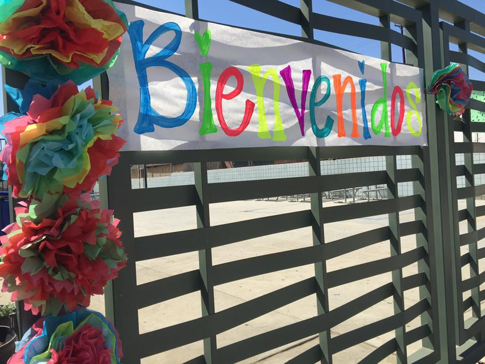 Academia Avance outdoor 2021 Welcome Back BBQ with banner sign saying  Bienvenidos
