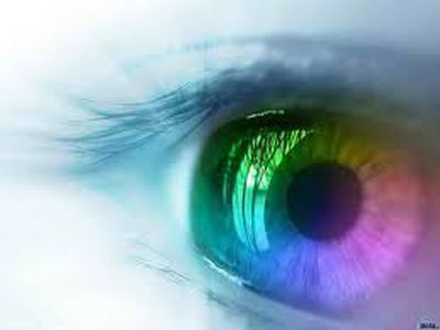 Close up of an eye with a rainbow multicolor iris
