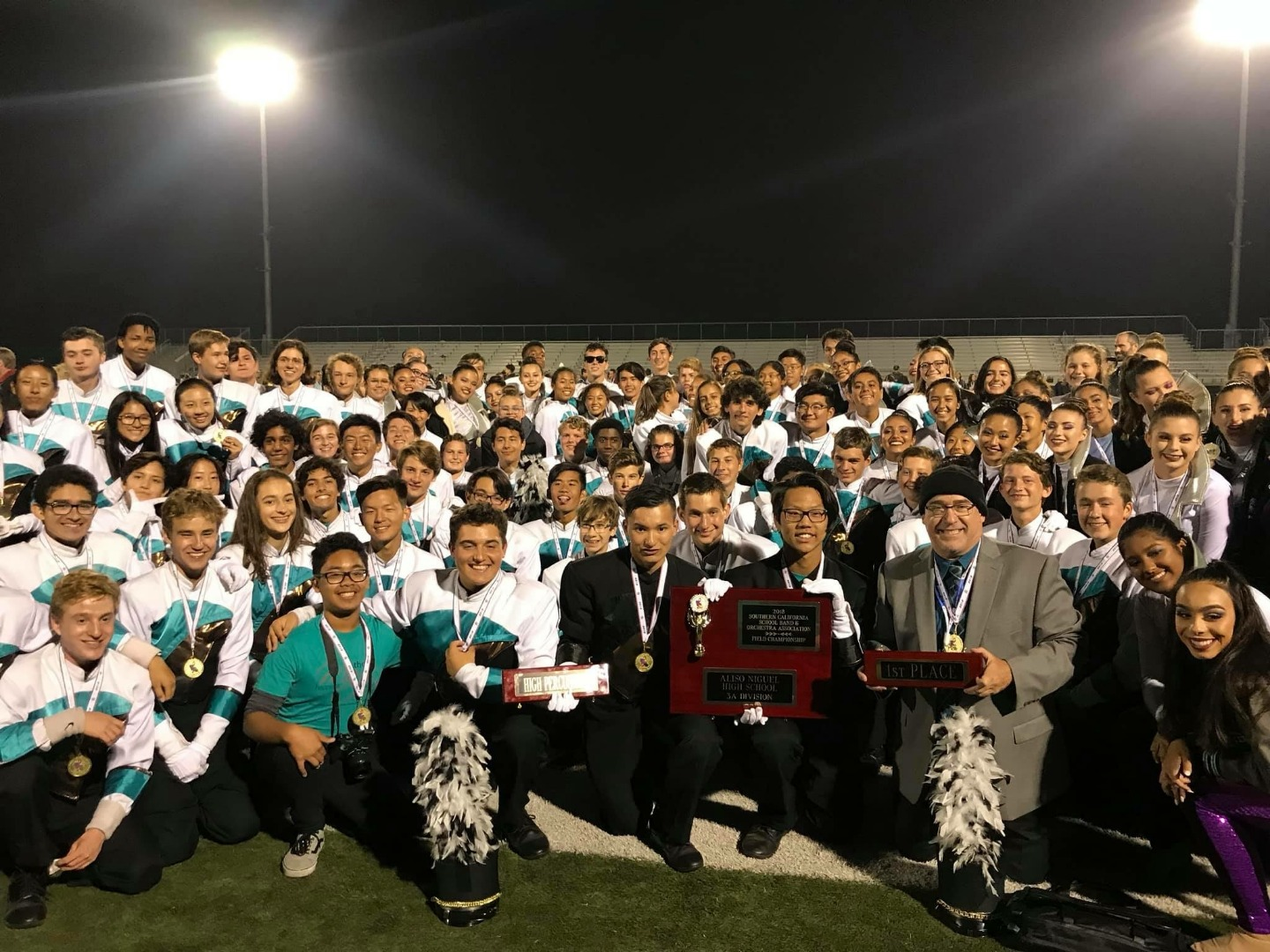 marching band on the field with all their sweepstakes awards
