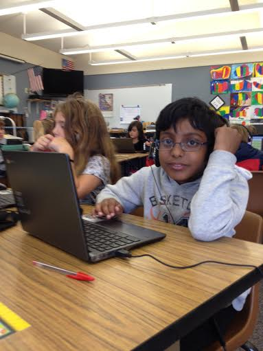 student with a chromebook