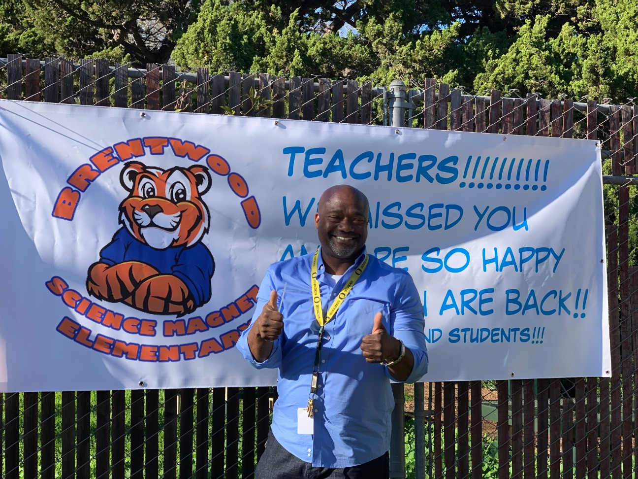 Principal with Welcome Back banner