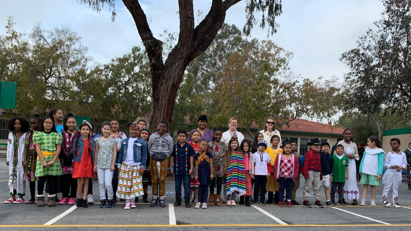 students in cultural clothing