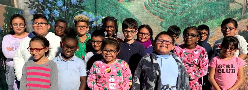 Students wearing new glasses