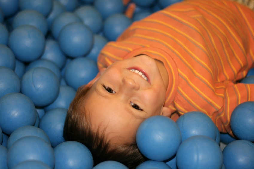 preschool boy in ball pit