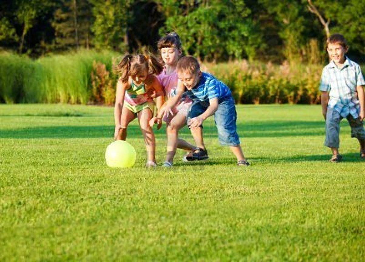 group-of-happy-preschool-kids-catching-the-ball