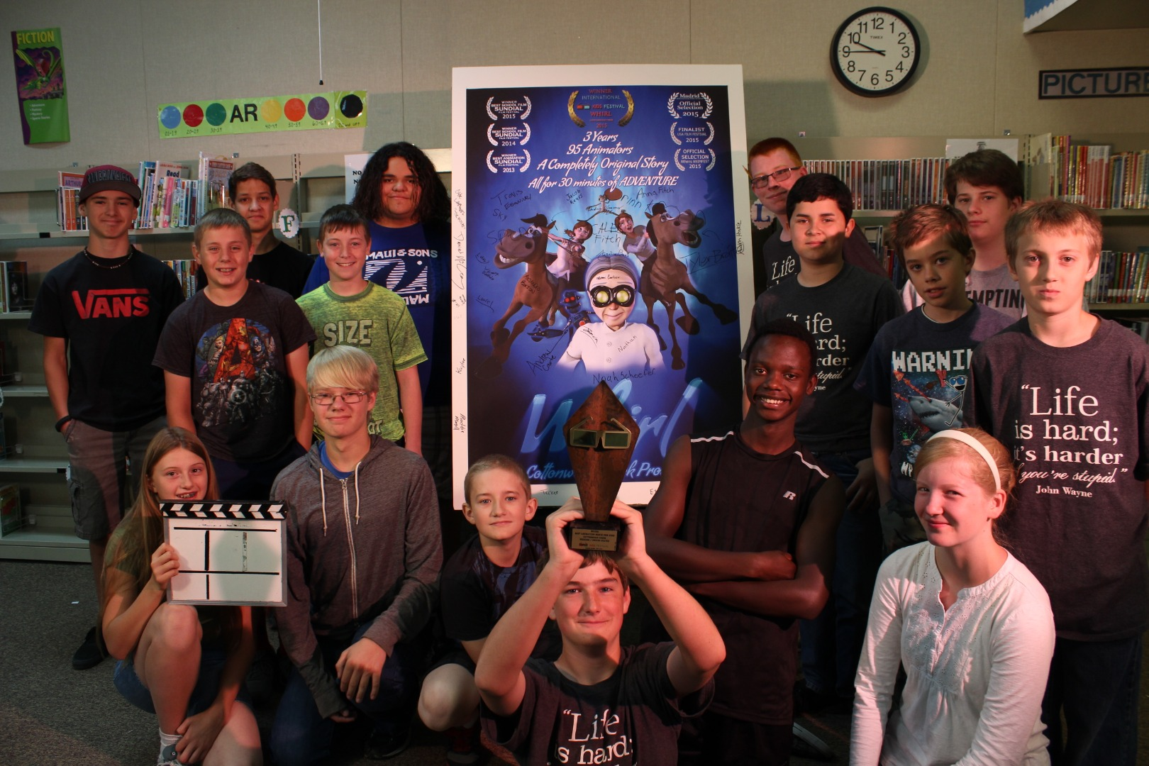Project Spark kids with award