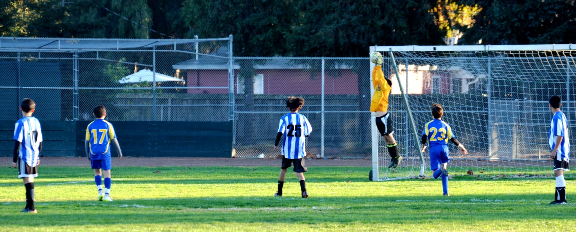 Boys Soccer Goalie making a save