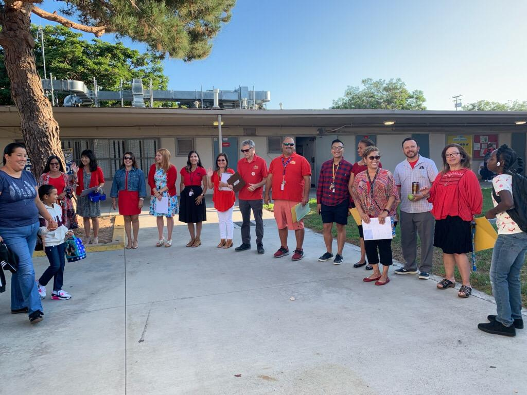 Staff welcoming students on the first day of school