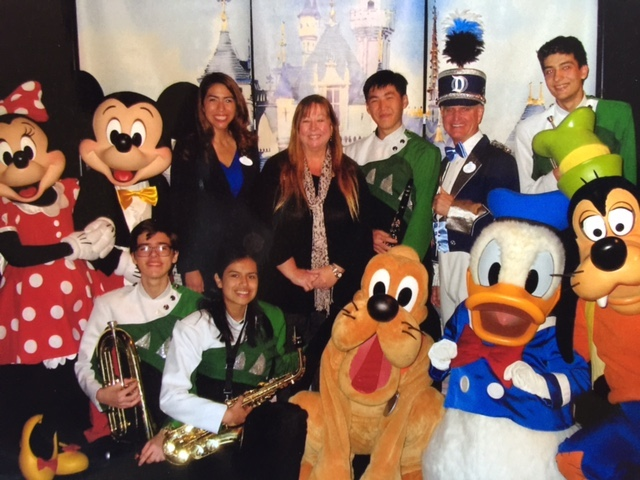 Disney Characters and representatives with the CMHS band students and teacher