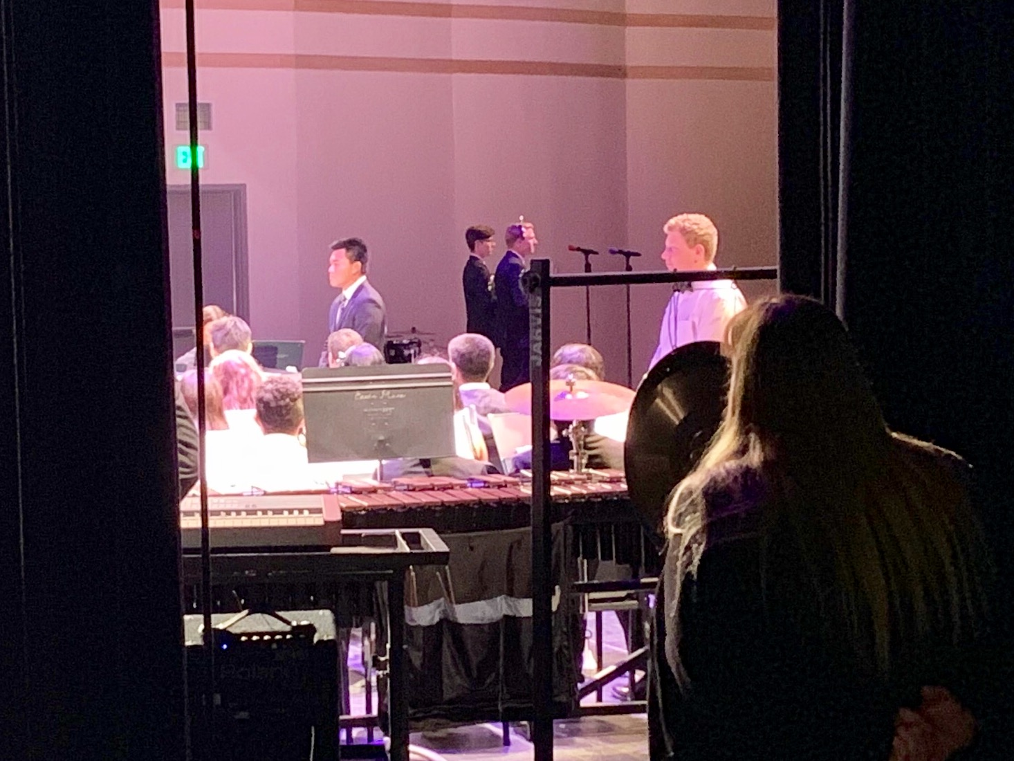 Mrs. Gilboe looks on backstage at the Sounds of the Season 2018