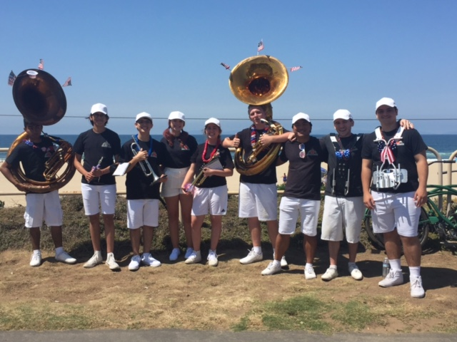 Band members getting ready for parade on PCH