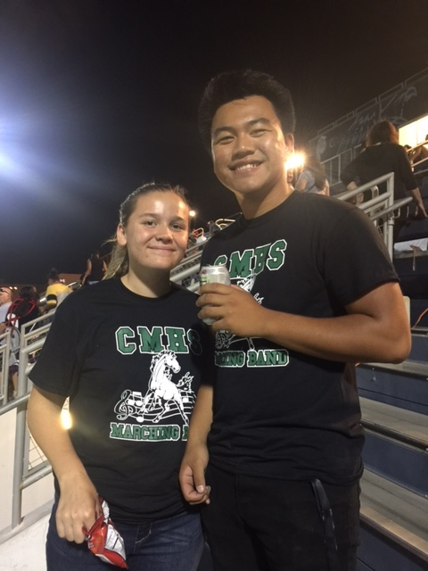 Kelsey and Han at football game