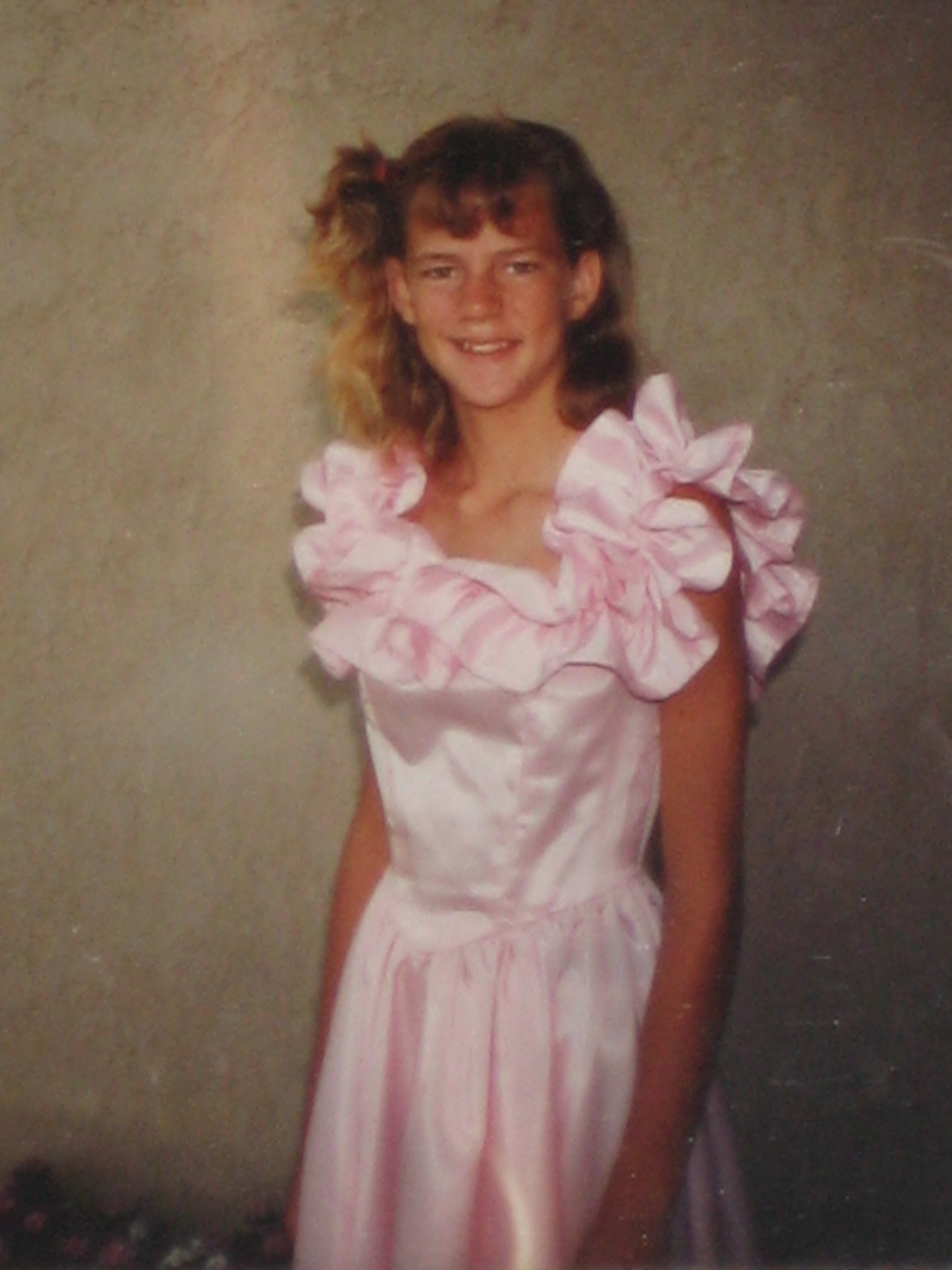 Me at my 8th grade graduation in 1987.