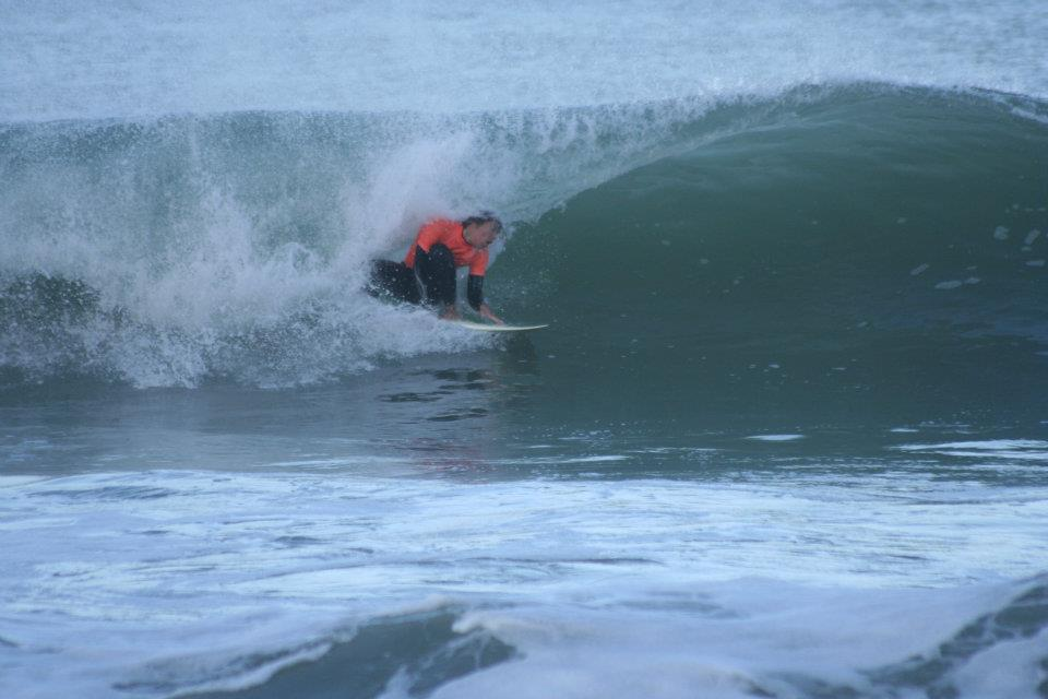 Surfer riding wave 6