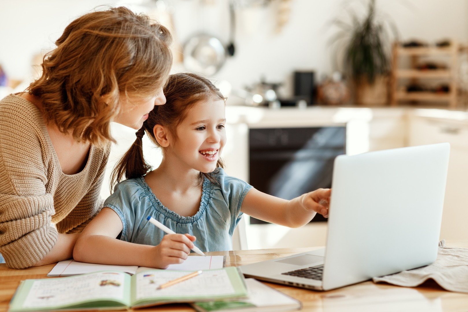 parent and child doing school work at home