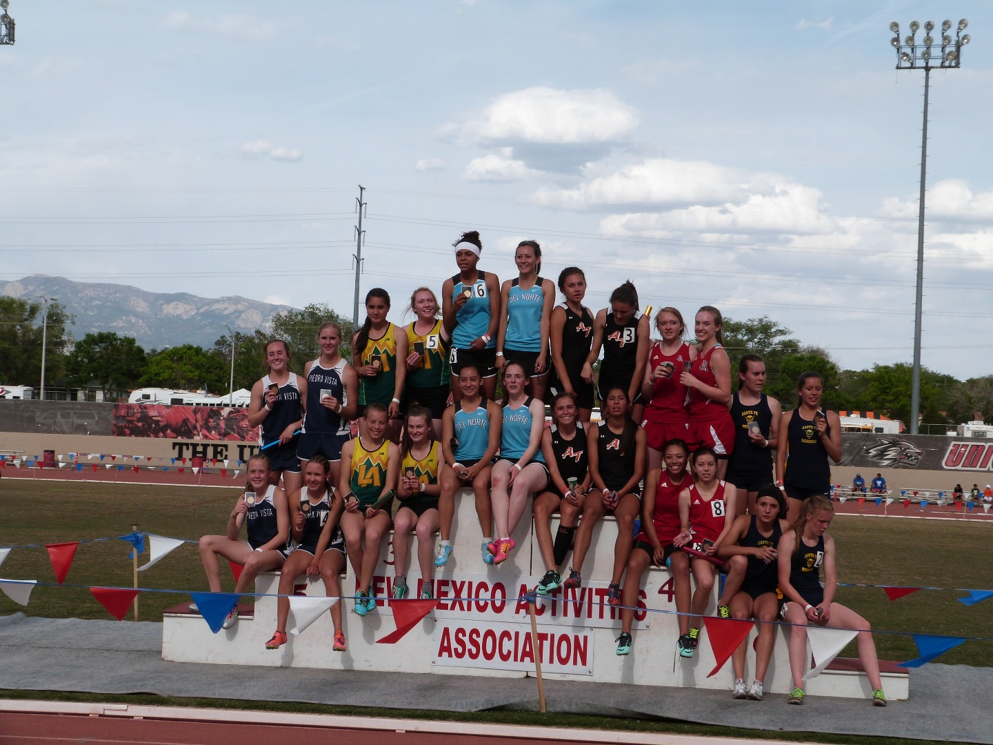 Girl's track team winners on podium
