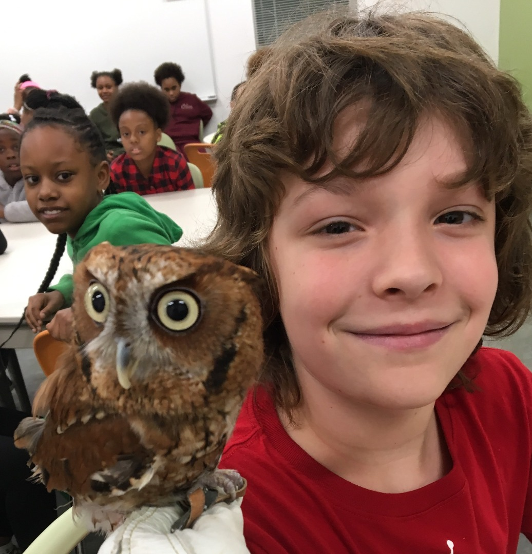 Student with June the Eastern Screech Owl