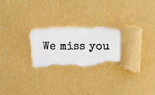 We miss you message under torn paper