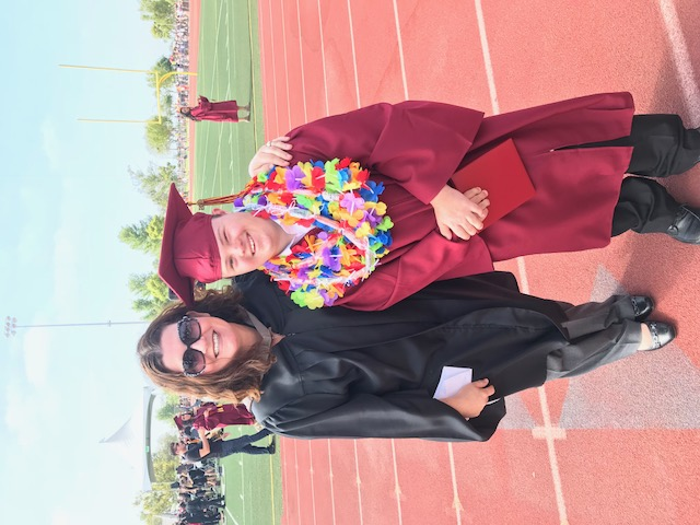 Mrs. Atkins with her student graduating from EHS