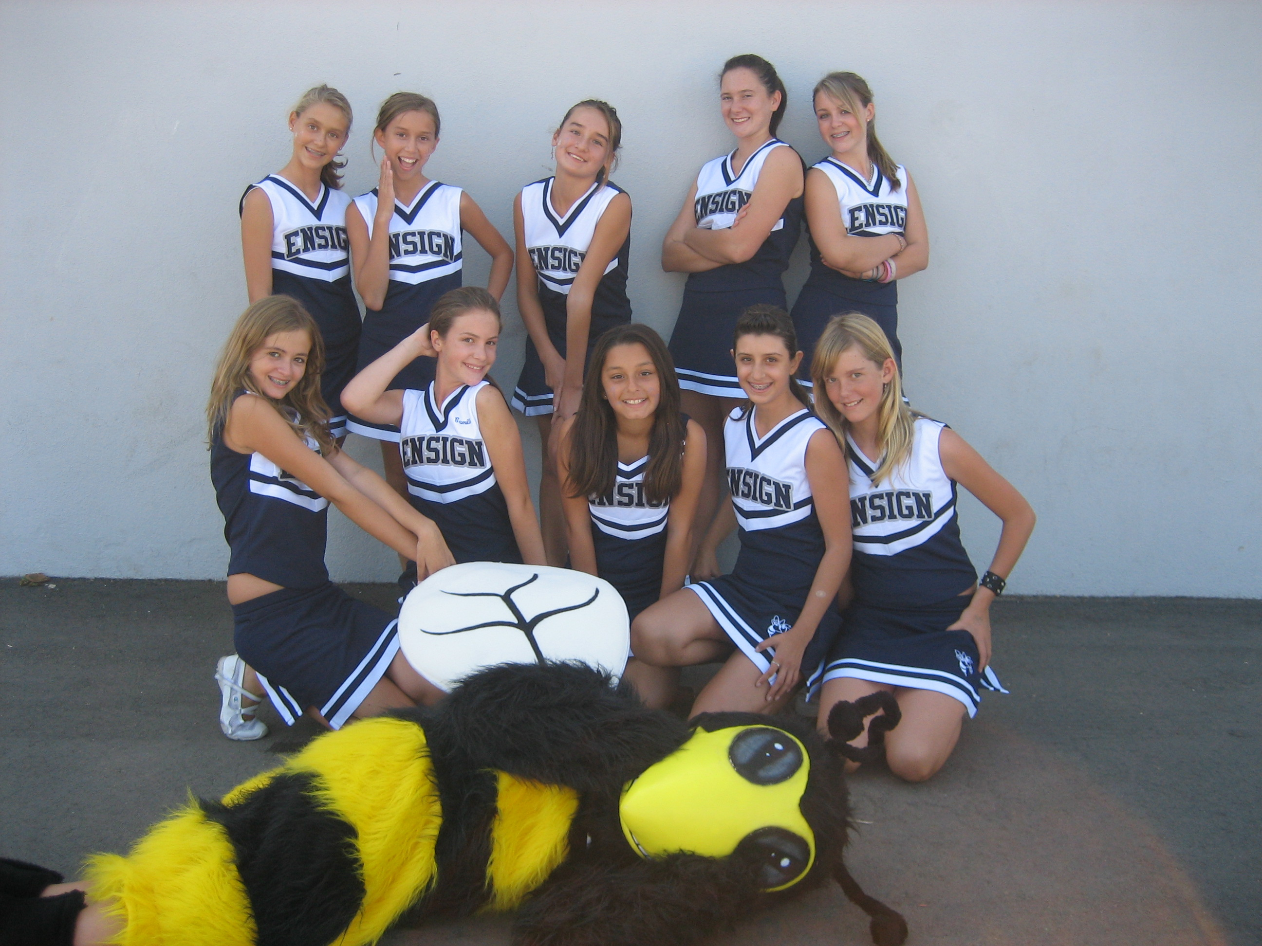 Cheerleaders with Seabee mascot