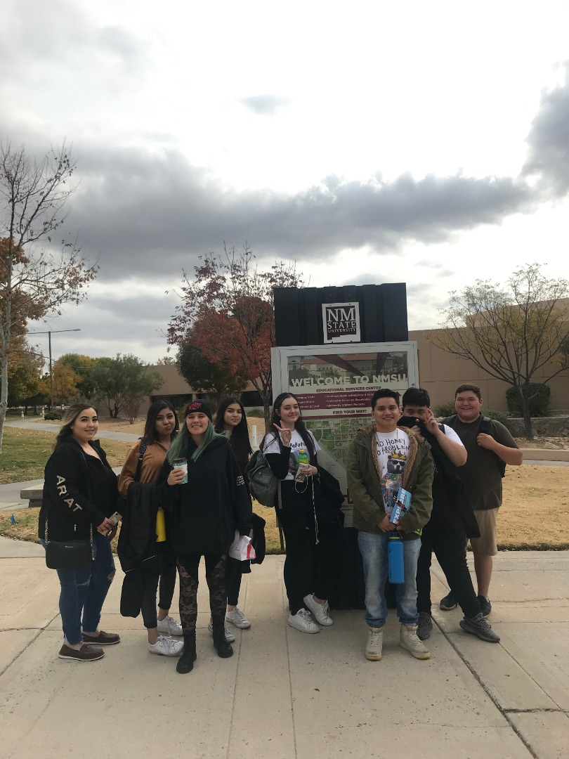 Students in front of an NMSU campus map