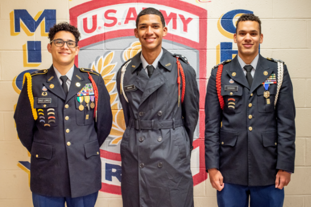JROTC Officers standing in front of Army Shield
