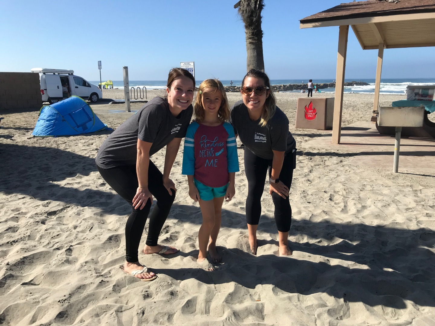 teachers and students beach clean up