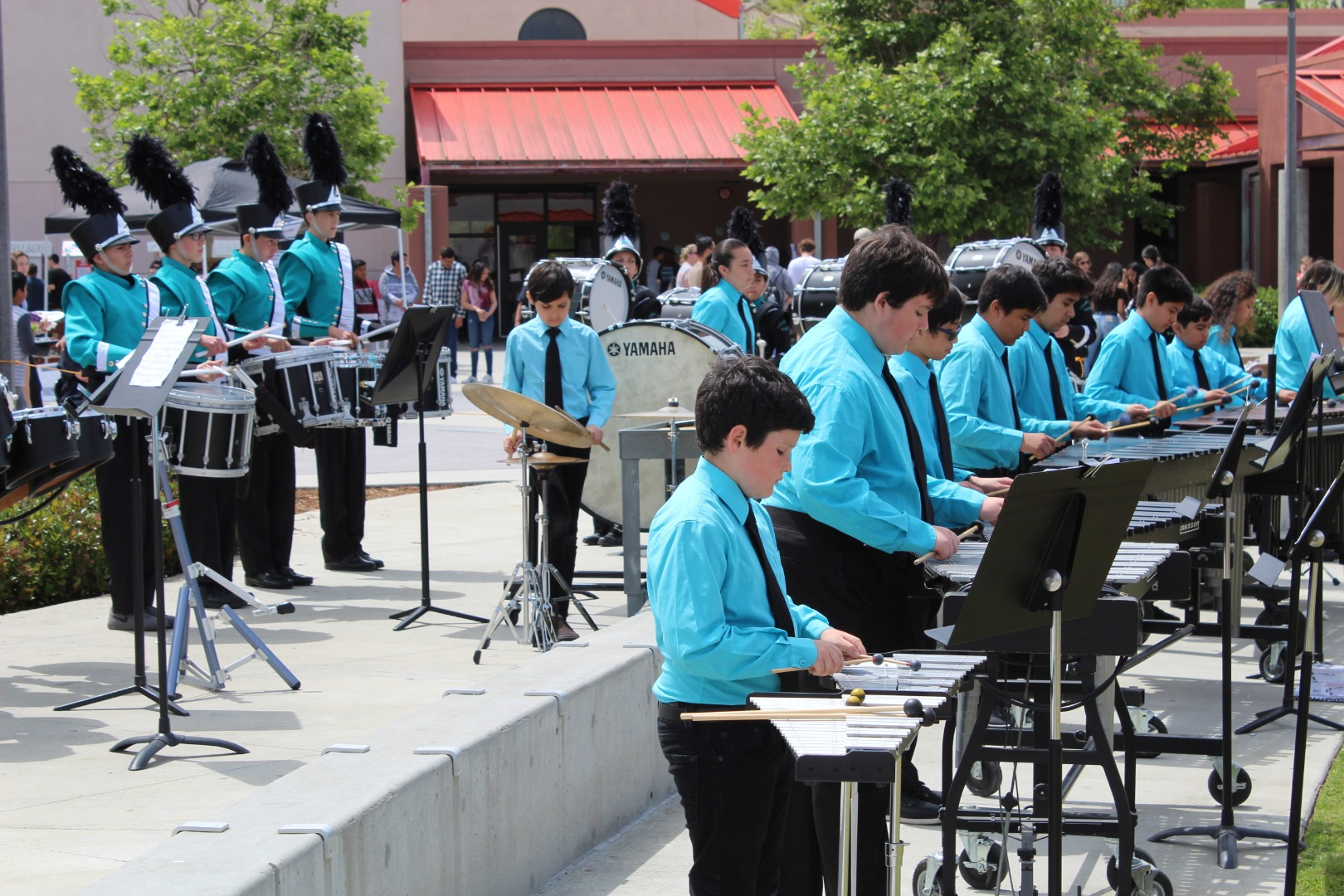 drum line students performing on campus