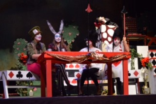 students performing Alice in Wonderland
