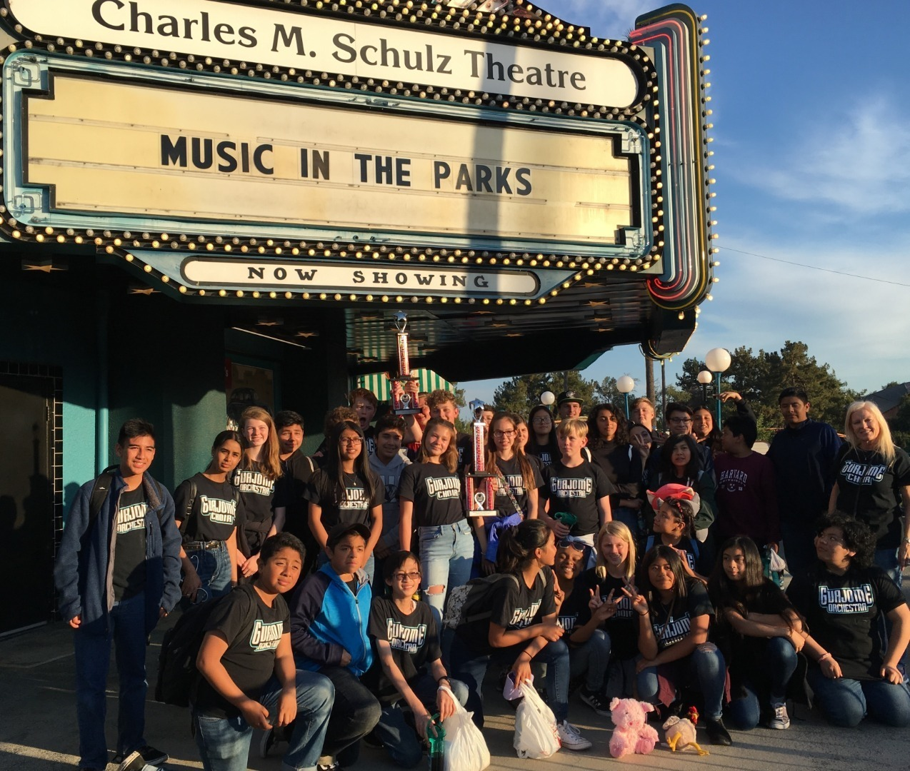 choir students with their trophy at Music in the Parks festival