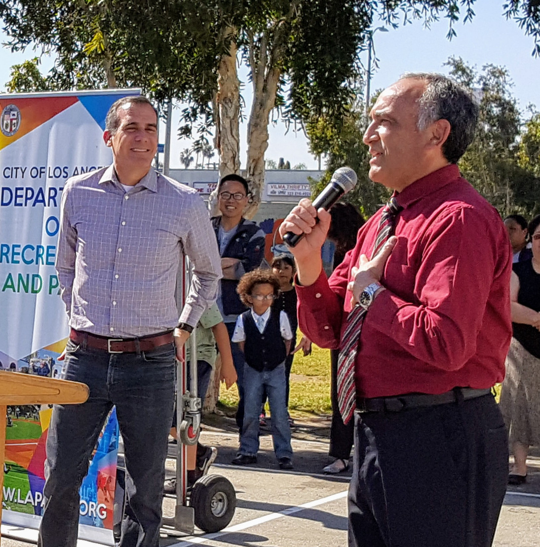 Mr. Paz with Mayor Garcetti looking on