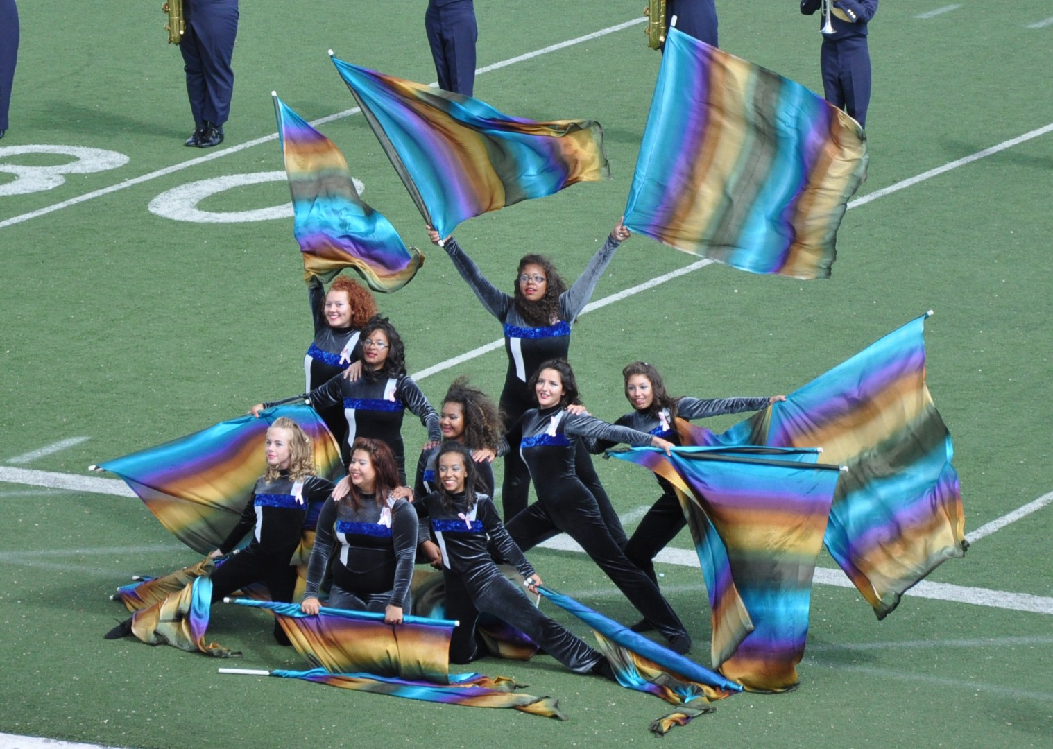 Highland dance team performs on football field