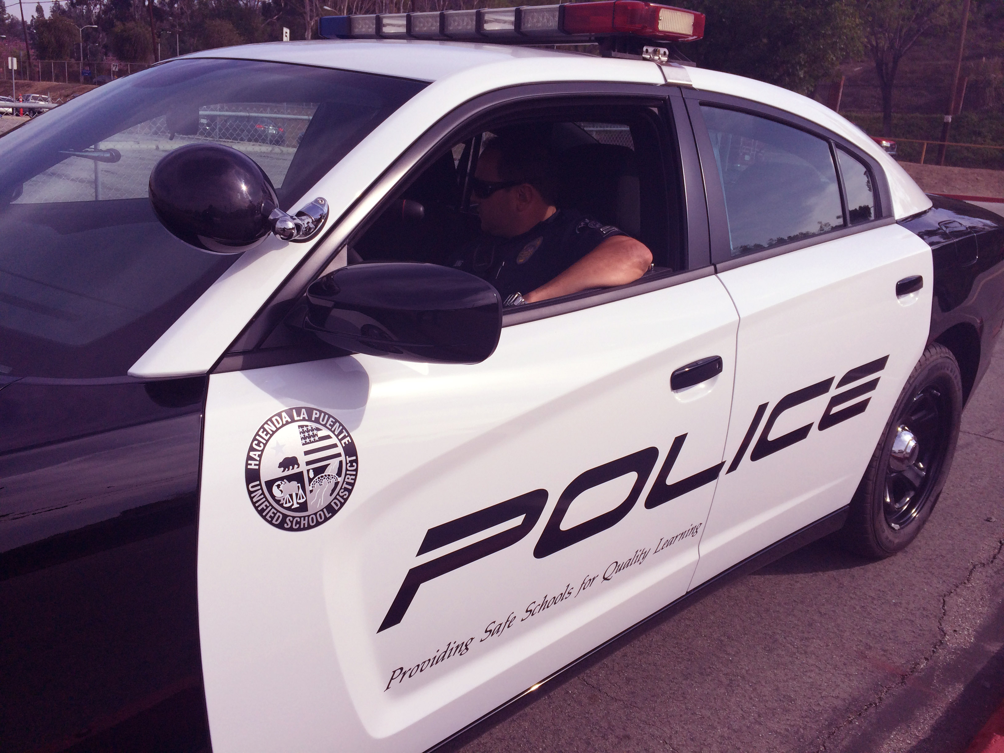 Police officer sitting in a police car