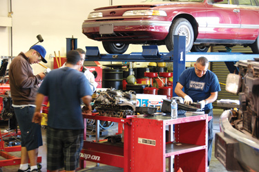 Adult students in auto workshop