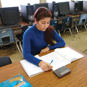 Female adult student working at a desk