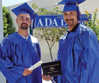 Adult High School Graduate students in their graduation gowns