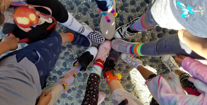 Students showing off their colorful socks