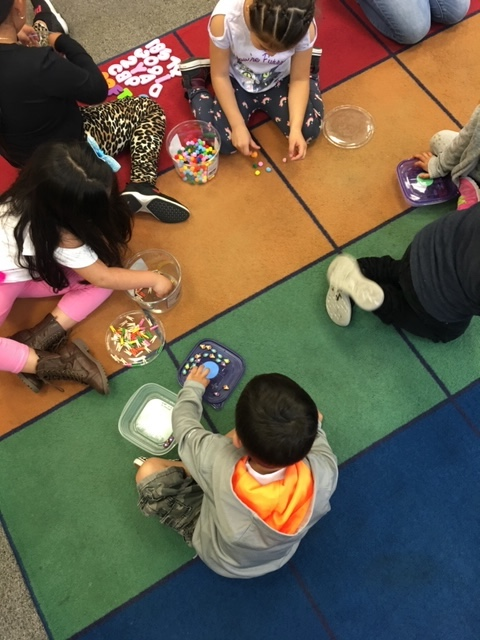 TK students engaged in Counting Collections.