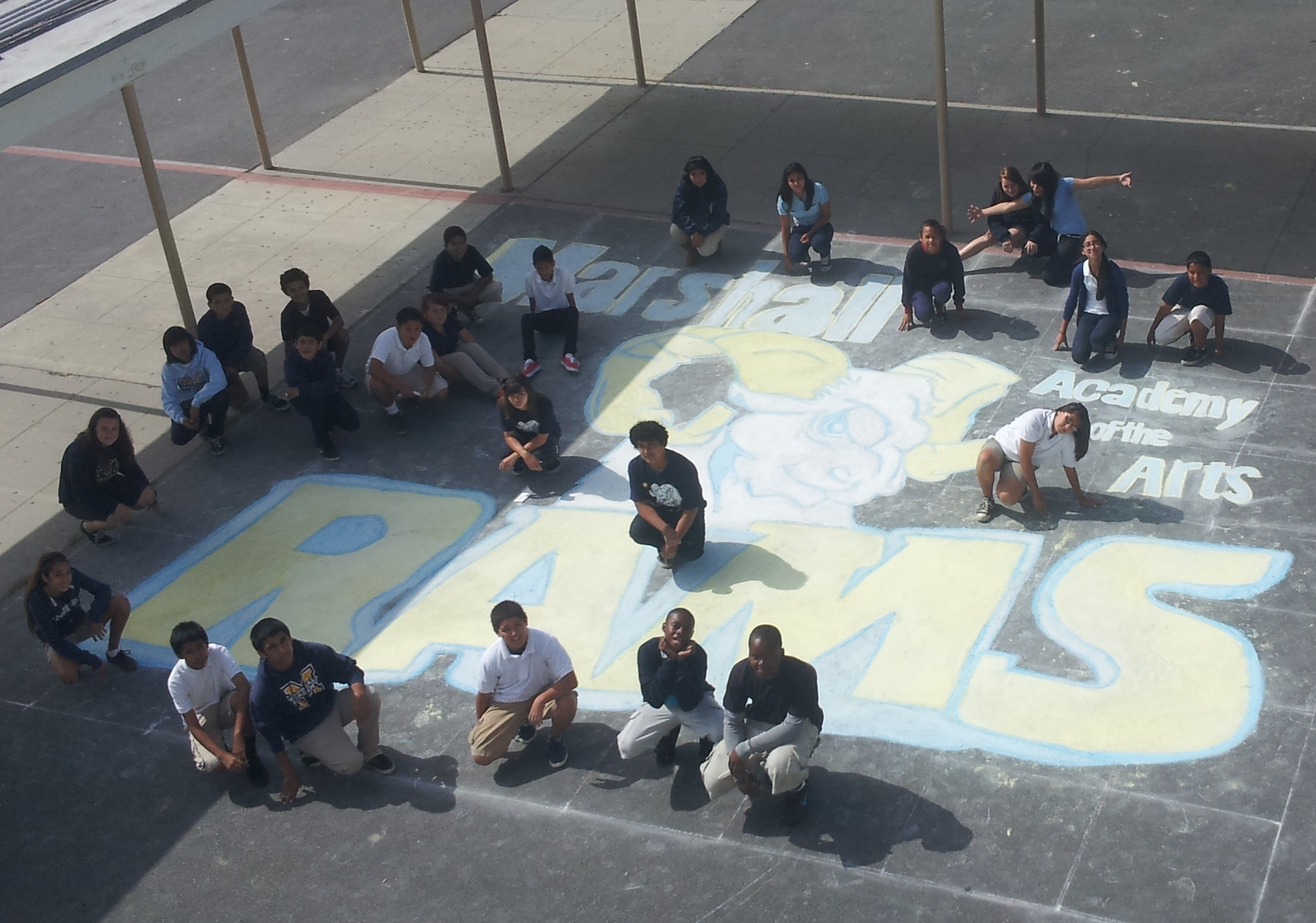 Students with chalk draw
