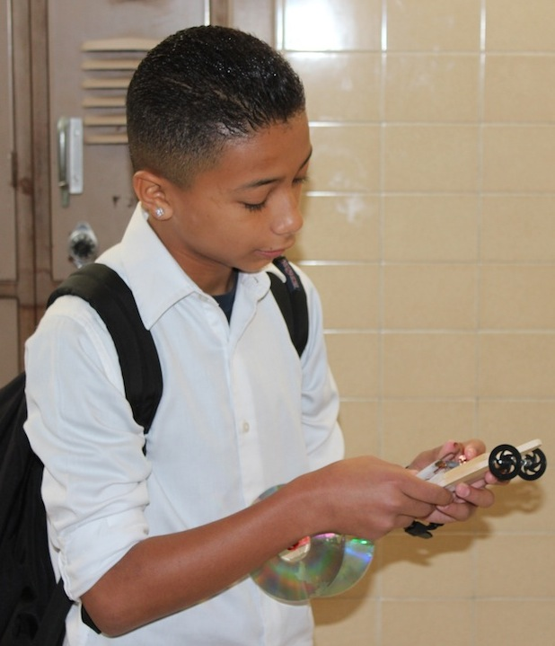 Student holding toy