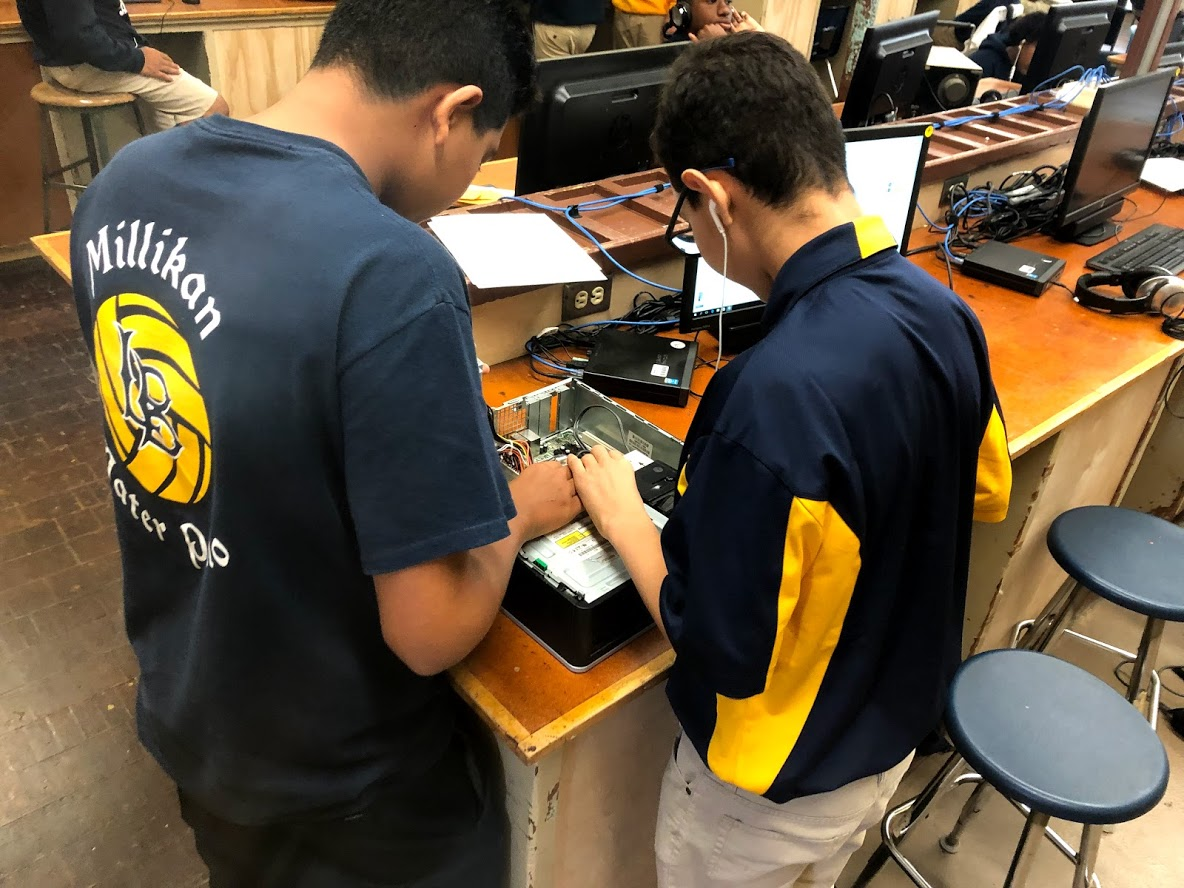 students dissecting computer