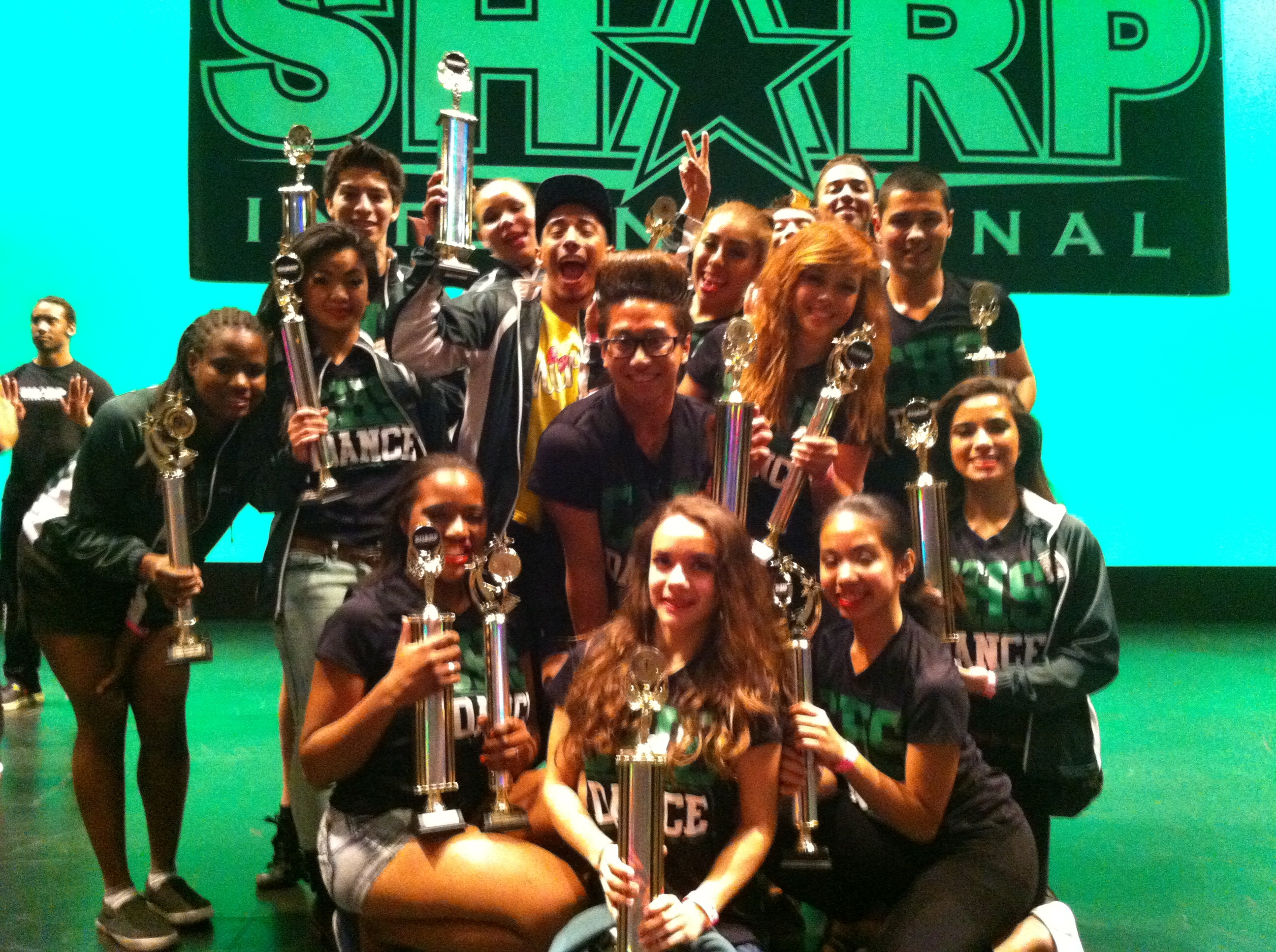 Dancers holding trophies
