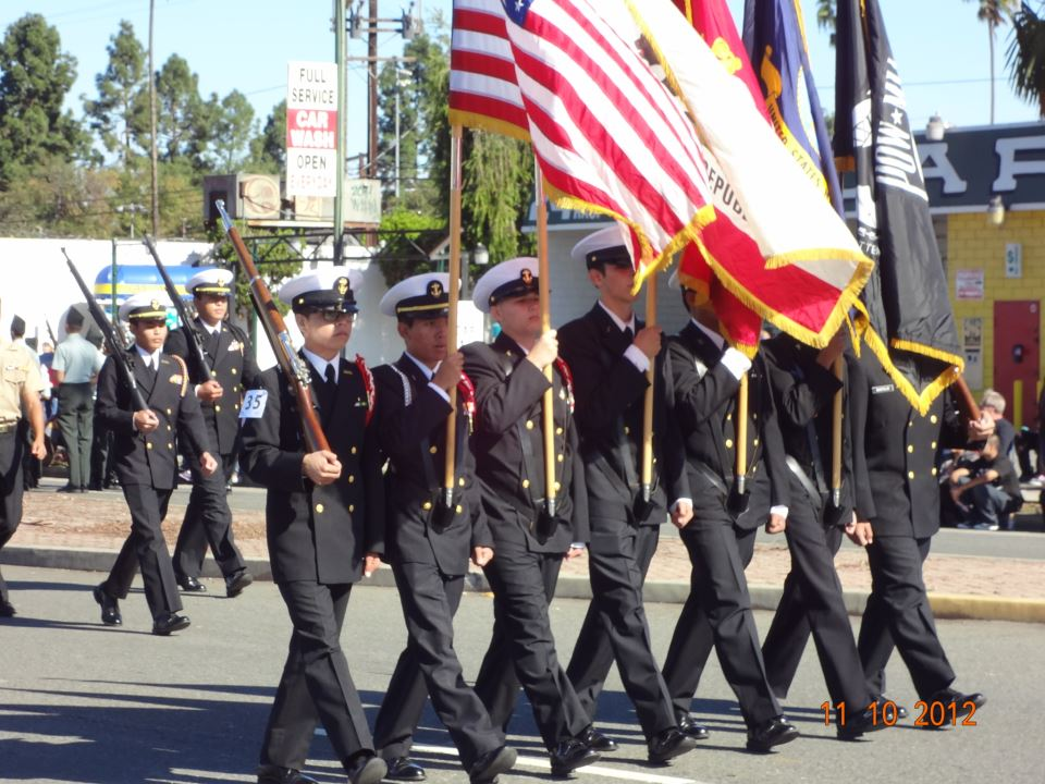 Carrying flags while marching in step