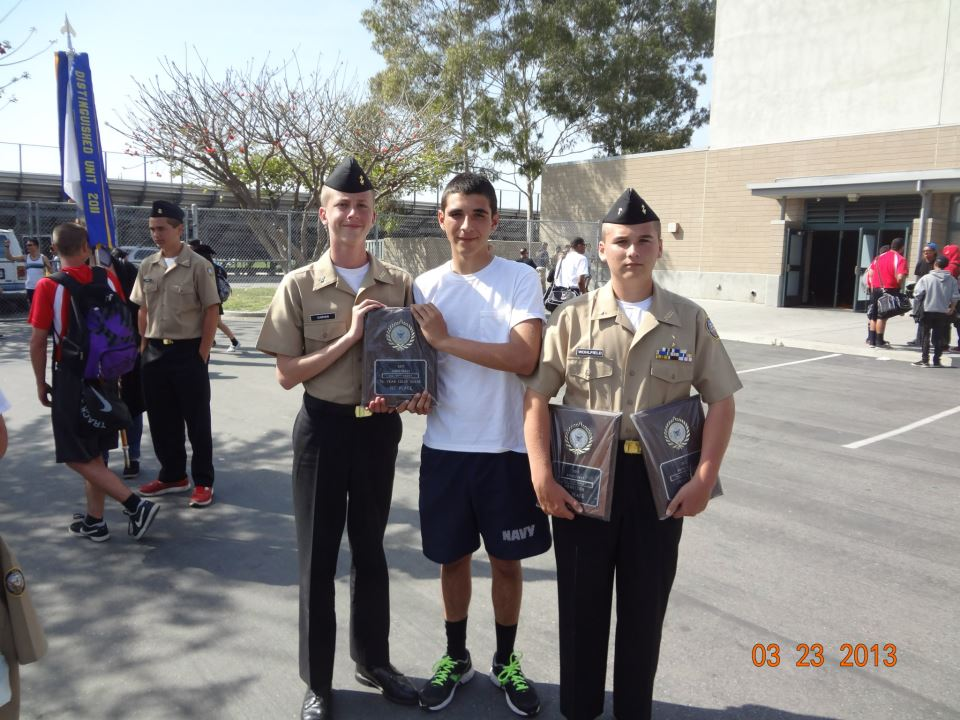 Proud young men with award plaques