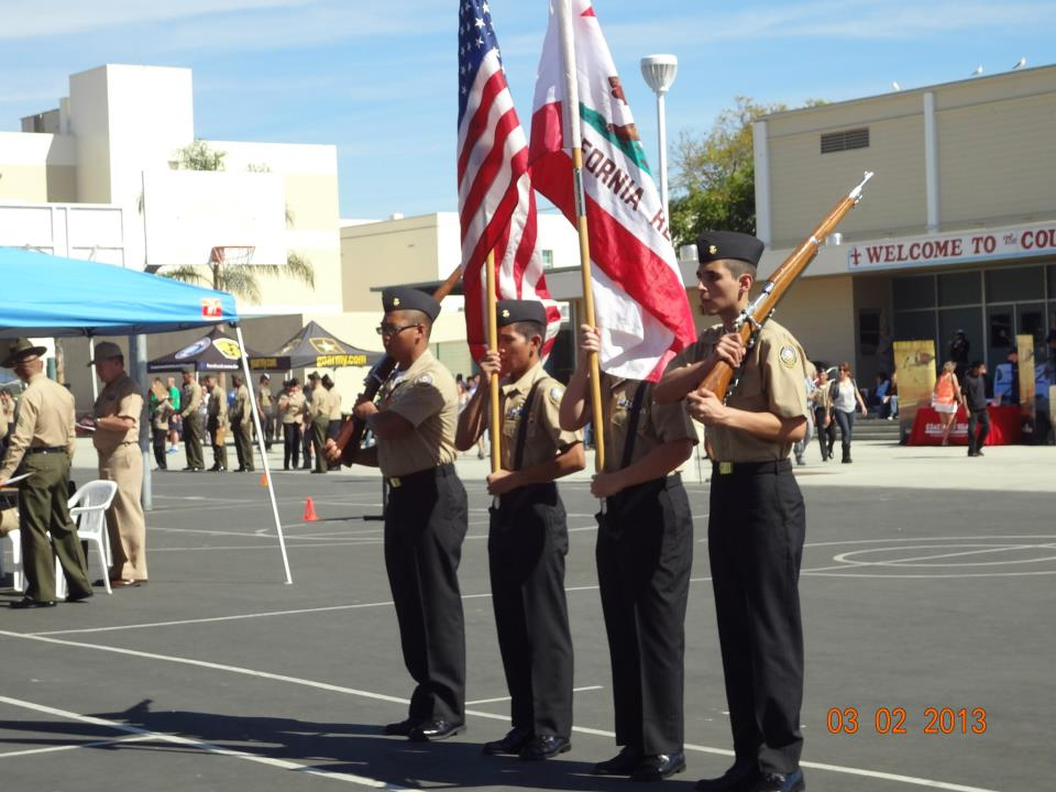 Colorguard carrying multiple flags