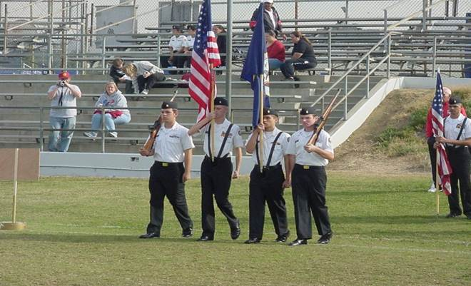 Carrying flags onto the field