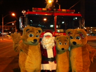 mascots at Parade with Santa